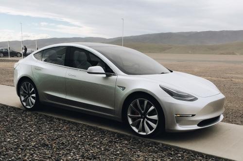 Tesla-Model-3-with-rocks.jpg