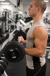 15396-a-healthy-young-man-lifting-weights-in-a-gym-pv.jpg
