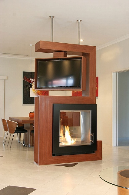 Awesome-room-divider-holds-turnable-TV-and-fireplace.jpg