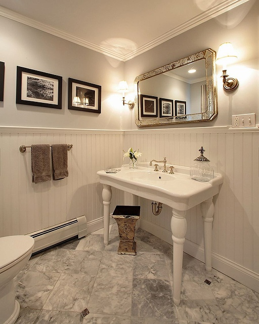Beautiful-traditional-powder-room-in-white-with-a-dash-of-black.jpg