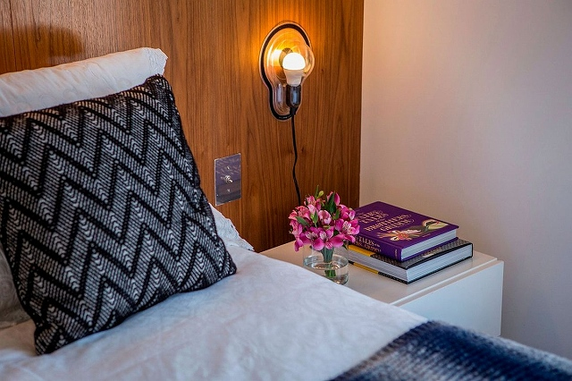 Bedside-lighting-saves-space-and-adds-a-hint-of-industrial-style.jpg