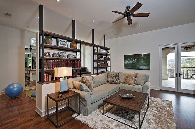 Bookshelf-room-divider-with-half-wall-offers-ample-display-space.jpg