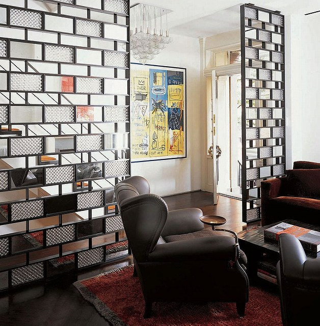 Bronze-plates-glass-and-mirrors-shape-a-stunning-room-divider.jpg