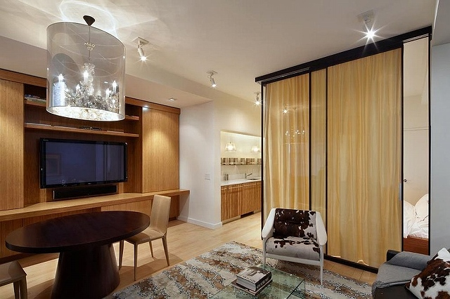 Custom-glass-wall-room-divider-with-drapes-encloses-the-bedroom.jpg