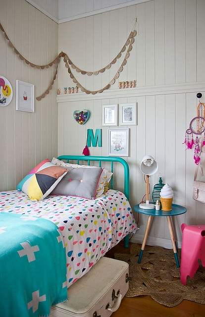 Decor-and-bedding-bring-the-color-into-this-eclectic-bedroom.jpg