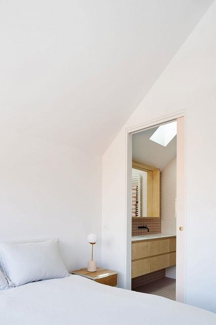 Floating-wooden-vanity-in-the-bathroom-next-to-the-master-bedroom.jpg