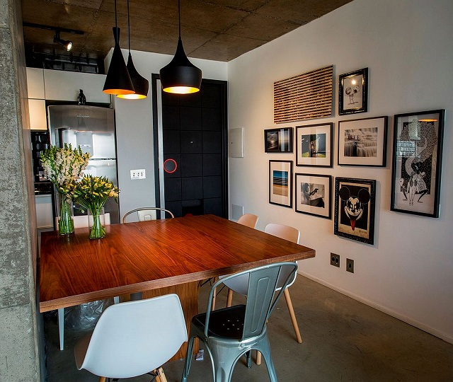 Framed-artwork-in-the-dining-room-adds-fun-and-playfulness-to-the-setting.jpg