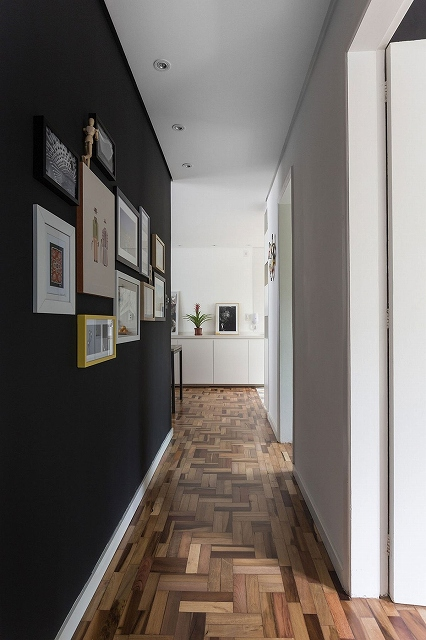 Gallery-wall-leads-way-to-the-bedrooms-from-the-living-space.jpg