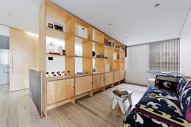 Make-the-most-out-of-your-room-divider-by-using-it-as-a-display-and-storage-unit.jpg