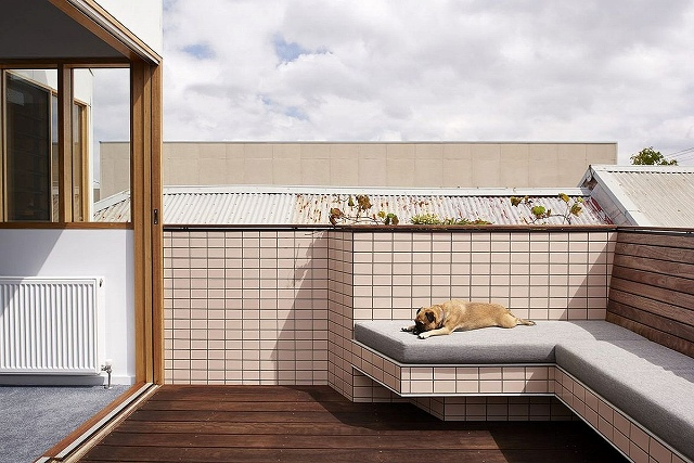 Outdoor-terrace-and-lounge-with-custom-bench-that-ofers-plush-seating.jpg