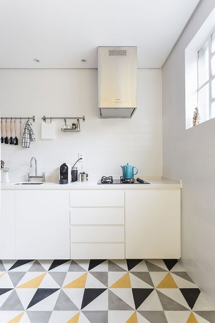 Small-kitchen-design-in-white-with-a-counter-that-leads-to-the-dining.jpg