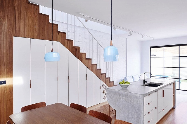 Storage-space-under-the-staircase-with-a-series-of-cabins.jpg