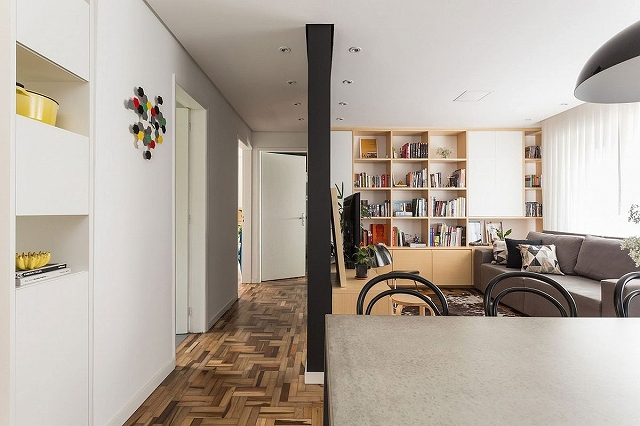 Unique-herringbone-pattern-of-the-floor-adds-to-the-style-of-the-small-apartment.jpg
