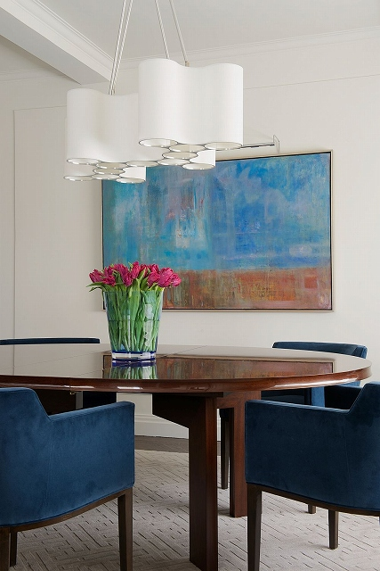 Wall-art-complements-the-color-scheme-of-the-dining-room.jpg