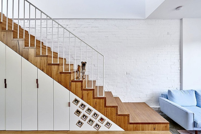 Wine-storage-and-additional-storage-shelves-under-the-staircase.jpg