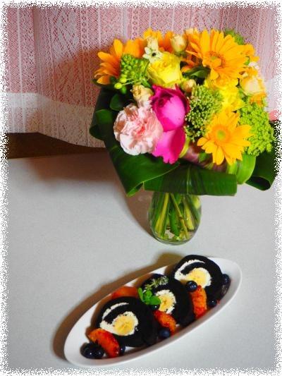 バースデイケーキと花