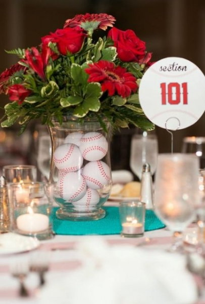 Baseball-themed-table-centerpiece-with-red-flowers.jpg